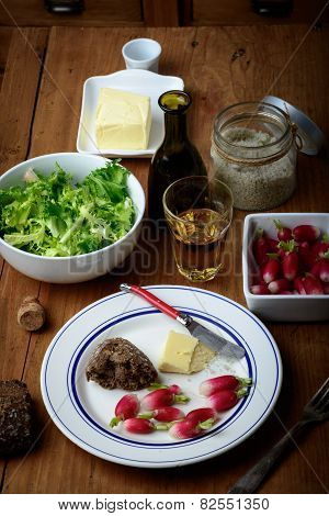 Plate With Radish And Butter On A Table