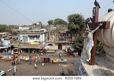 KOLKATA, INDIA - FEBRUARY 10, 2014: Crucifix on top of the Nirmal Hriday, Home for the Sick and Dying Destitutes established by the Mother Teresa and run by Missionaries of Charity in Kolkata, India