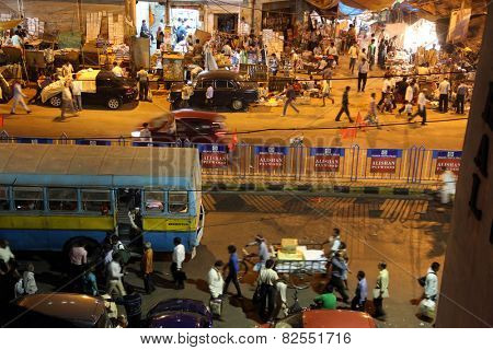 KOLKATA, INDIA - FEB 10: Dark city traffic blurred in motion at late evening on crowded streets on February 10, 2014 in Kolkata. Kolkata has a density of 814.80 vehicles per km road length