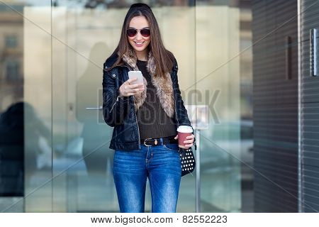 Young Beautiful Woman With Mobile Phone And Coffee.