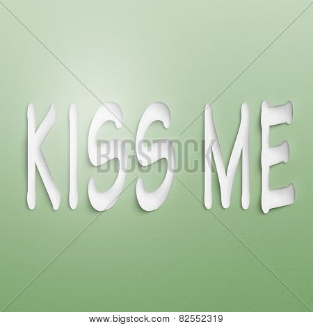 text on the wall or paper, kiss me