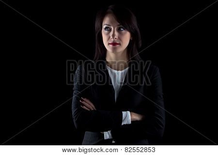 Photo of serious looking away business woman