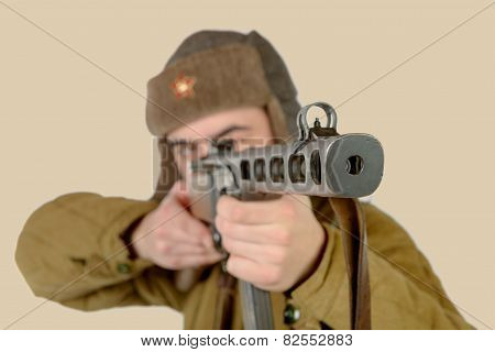 A Young Soviet Soldier Fires With A Machine Gun