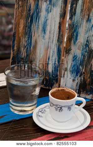 Cup Of  Coffee And Water On A Coffee Shop