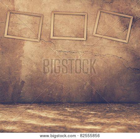 Grunge rusty interior with three grey frames, retro filtered, instagram style