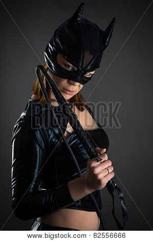 woman cat with whip