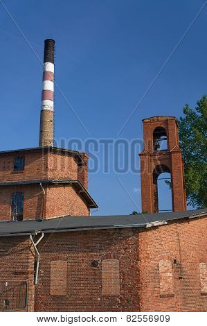 The chimney in old, brick distillery