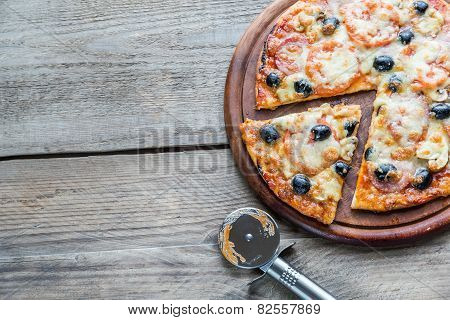 Cooked Pizza On The Wooden Board