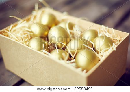 Golden Easter eggs in container