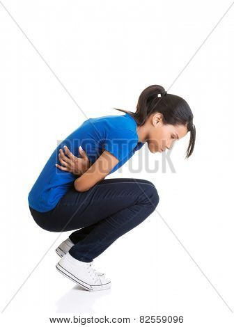 Woman is holding her stomach because of cramp