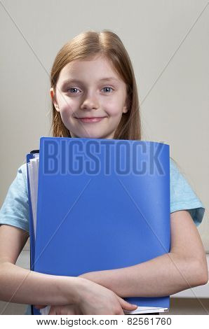 Schoolgirl With Folder