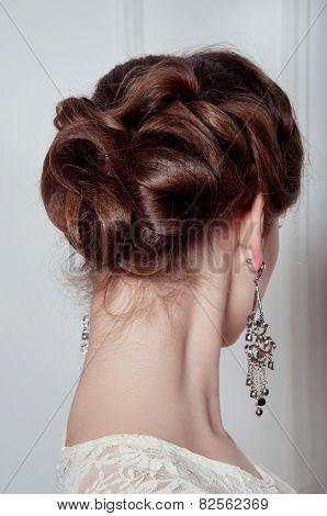 Studio Portrait Of Elegant Woman With Evening Hairdo