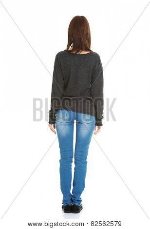 Young beautiful woman standing backside