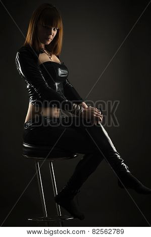 luxurious woman sitting on a bar stool