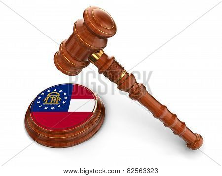 Wooden Mallet and flag Of Georgia (clipping path included)