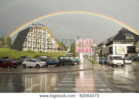 ZABLJAK, MONTENEGRO - JULY 27, 2014: rainbow on downtown Zabljak in the Durmitor mountain region and with an altitude of 1,456 metres, it is the highest situated town on the Balkans. Shot in 2014