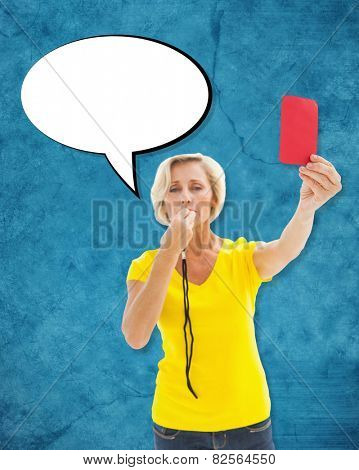 Mature blonde showing red card to camera against blue