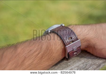 Man's arm wearing watch