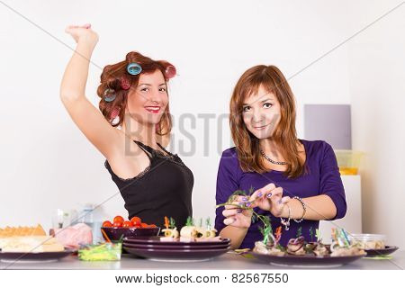 Two Young Pretty Woman Housewife Cooking With Curlers