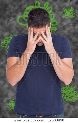 Man with headache against squiggly line