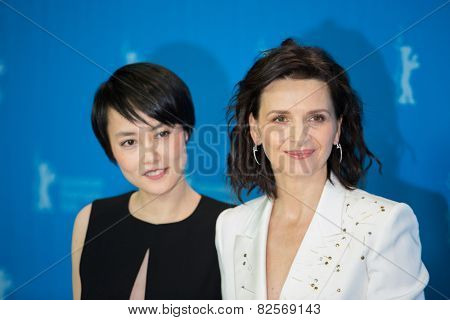 BERLIN, GERMANY - FEBRUARY 05: Rinko Kikuchi, Juliette Binoche, 'Nobody Wants the Night'. 65th Berlinale International Film Festival at Grand Hyatt Hotel on February 5, 2015 in Berlin, Germany.