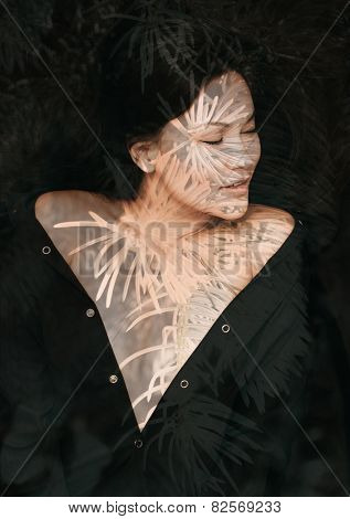 Double exposure portrait of attractive woman combined with photograph of fir