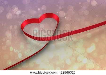 Red ribbon heart against pink abstract light spot design