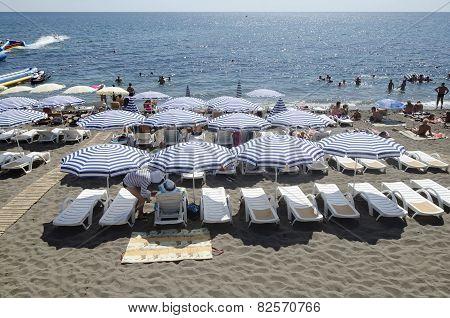 Resting Under A Sun Umbrella On The Beach