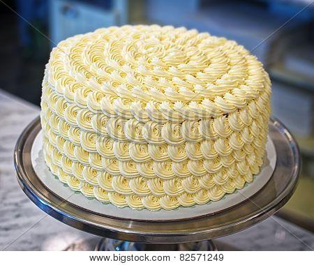 Round Creamy Cake On The Bakery Storefront
