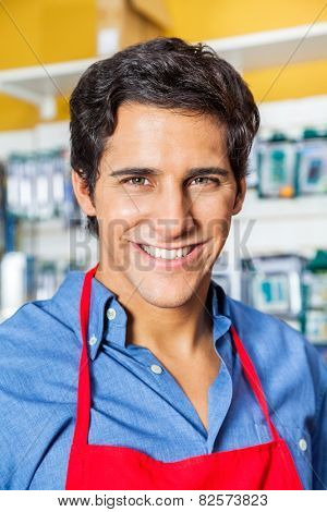 Portrait of confident male worker smiling in hardware shop