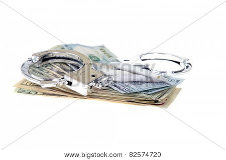 medical marijuana, money, and Hand Cuffs isolated on white. Representing the confusion of Legal Medical Marijuana and the laws between States and the US Government. Medical Marijuana is a legal drug