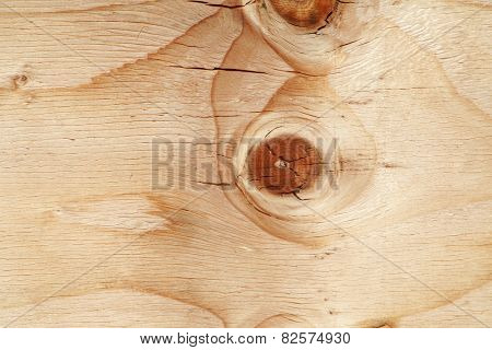 Wood for background or wall paper with a knot in the wood. Plywood is used around the world for many different things from building houses, boats, shipping containers and more, it is made from trees