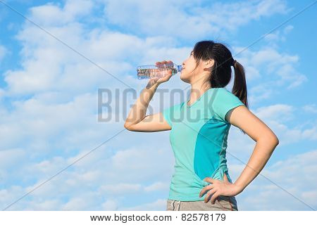 Asian Young Woman Drinking Water After Training