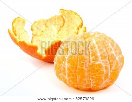 Single peeled tangerine or mandarin fruit with its skin on white background