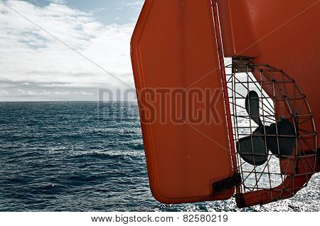 Lifeboat On Ferry Deck Flying Over The Sea