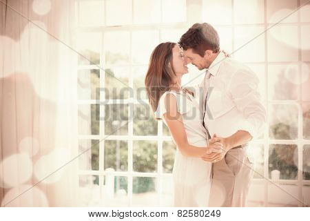 Side view of a loving young couple holding hands at home