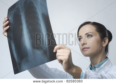 Female Doctor Examining X-ray Image