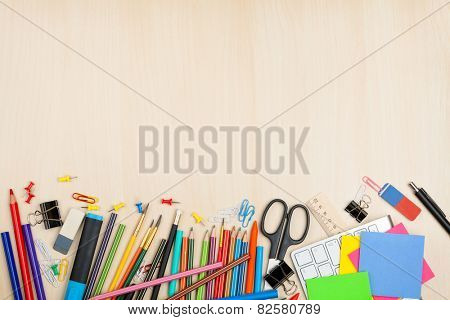 School and office supplies over office table. Top view with copy space