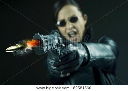 Female Agent Pointing A Gun