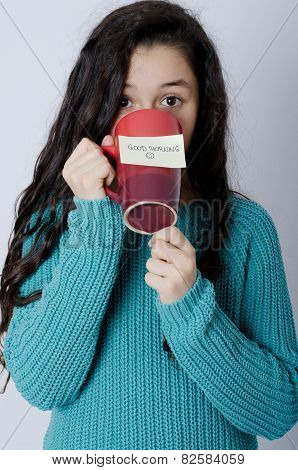 Young girl with note on mug - Good morning
