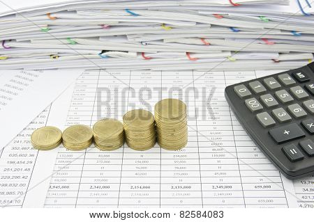 Step Of Gold Coin With Calculator On Finance Account