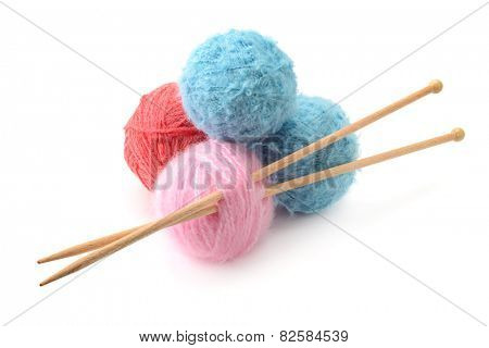 Woolen balls and knitting needles isolated on a white background