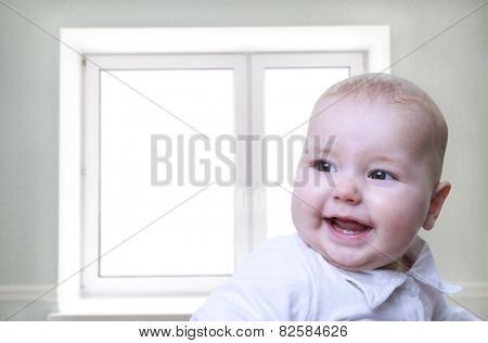 Smiling baby boy looking at camera