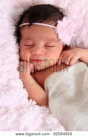 Beautiful smiling newborn baby girl.