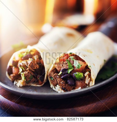 mexican beef steak burritos with black beans, rice, and salsa