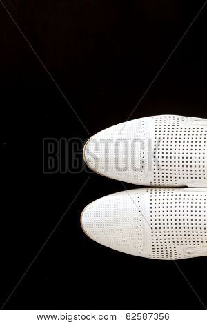 Male dress shoes, elegance wedding groom boots called derby shoes, leather white cloth empty shoes in horizontal orientation, nobody, isolated over black