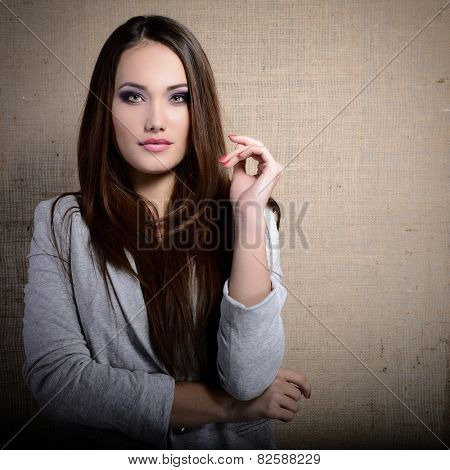 portrait of beautiful young woman indoor over canvas