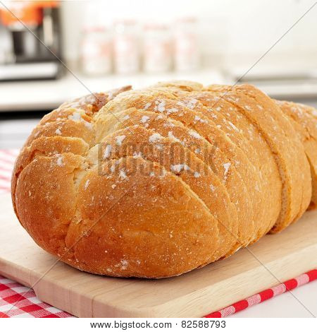 closeup of a sliced bread loaf on the kitchen table