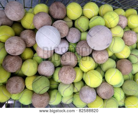Tennis Ball With Softball In Iron Basket