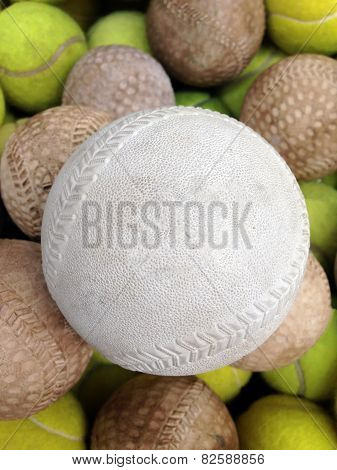 Softball With Tennis Ball In Basket
